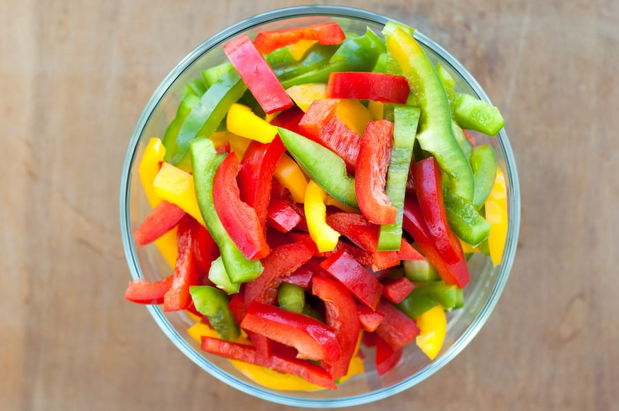 Colored peppers mixed in a bowl
