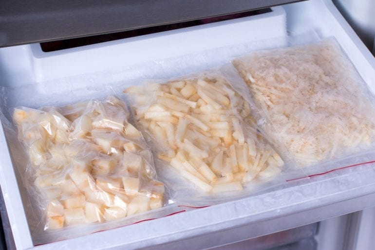 Frozen potatoes in bags in the freezer