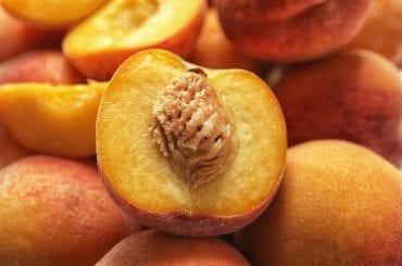 Pile of delicious ripe peaches