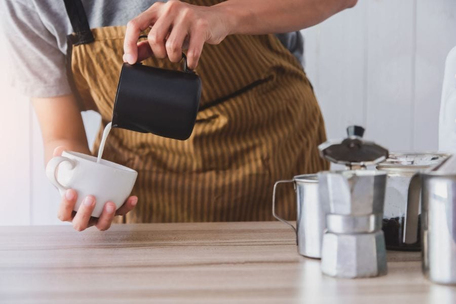 Pouring Milk in Coffee