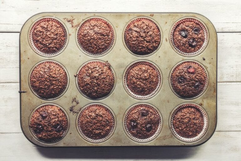 Chocolate Bran Muffins With Cherries in Muffin Pan
