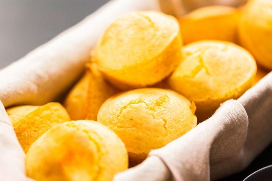 Freshly Baked Cornbread Muffins in Basket