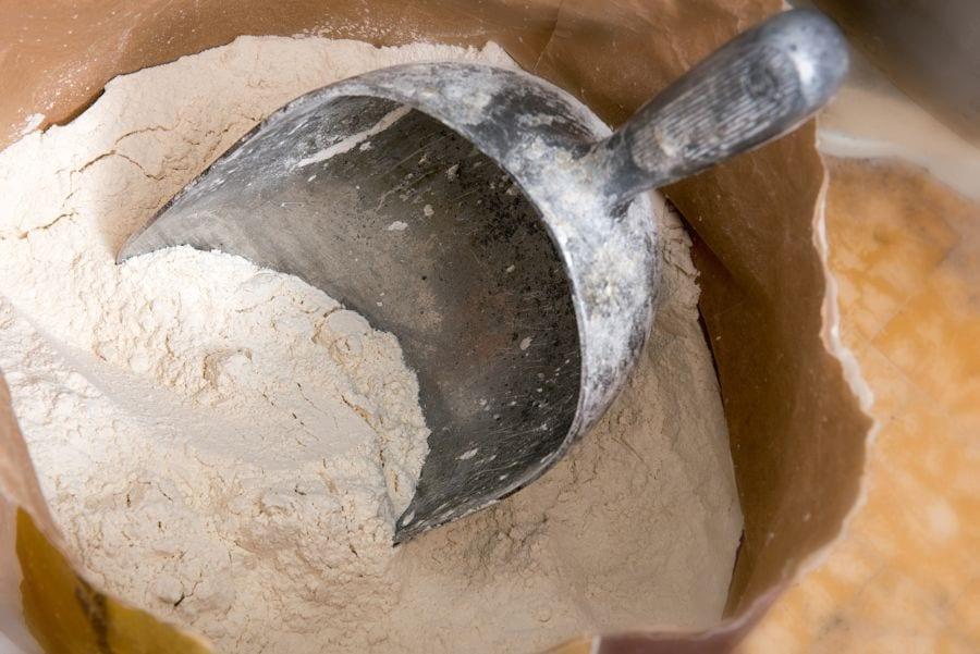 Large Metal Scoop in Bag of White Flour